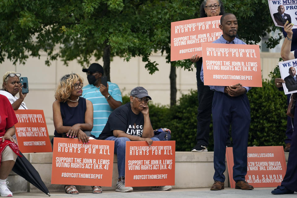 People listen during a voting rights rally at Liberty Plaza near the Georgia State Capitol on Tuesday, June 8, 2021, in Atlanta. (AP Photo/Brynn Anderson)