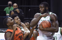 Oregon forward Eugene Omoruyi (2) comes down with a rebound next to Oregon State forward Dearon Tucker (35) during the first half of an NCAA college basketball game Saturday, Jan. 23, 2021, in Eugene, Ore. (AP Photo/Andy Nelson)