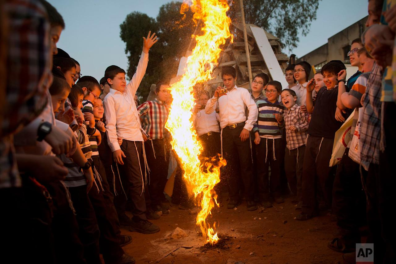 <p>Ultra-Orthodox Jewish youths play with fire during the Jewish holiday of Lag Ba'Omer in Bnei Brak, Israel. The holiday marks the end of a plague said to have decimated Jews during the Roman times. (AP Photo/Oded Balilty) </p>