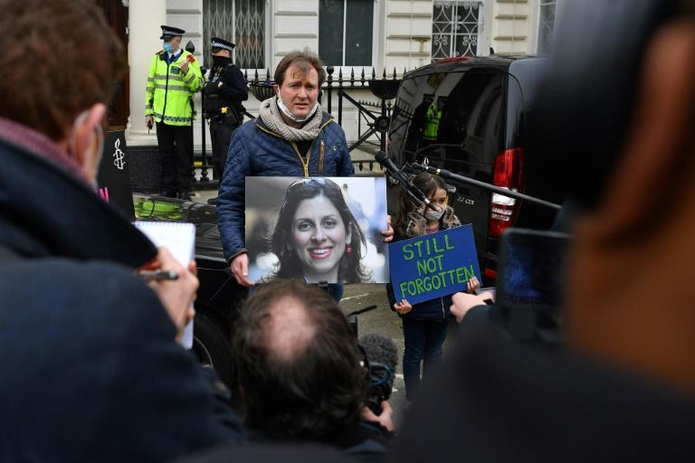 Richard Ratcliffe, husband of British-Iranian Nazanin Zaghari-Ratcliffe jailed in Tehran since 2016, and his daughter Gabriella, attend a protest outside the Iranian Embassy in London on March 8