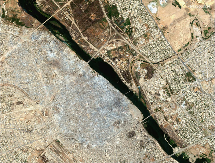 This July 8, 2017, image provided by Maxar Technologies shows the Old City of Mosul, Iraq, left, after a punishing nine month battle to oust Islamic State militants. (Satellite image ©2019 Maxar Technologies via AP)
