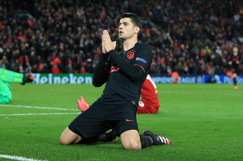 Alvaro Morata of Atletico slides and celebrates his goal after knocking Liverpool out.