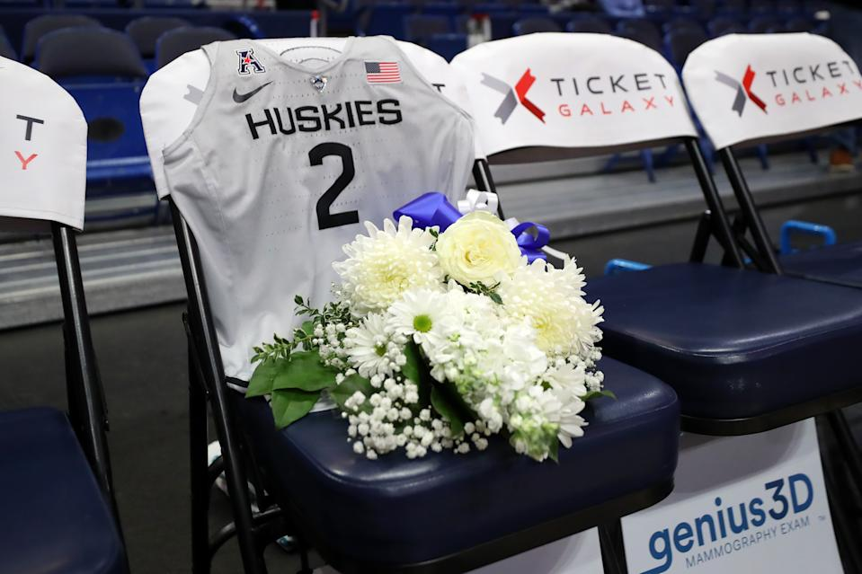 A jersey to honor Gianna Bryant sits on the UConn bench before the USA Women's National Team Winter Tour 2020 game between the United States and the UConn Huskies.