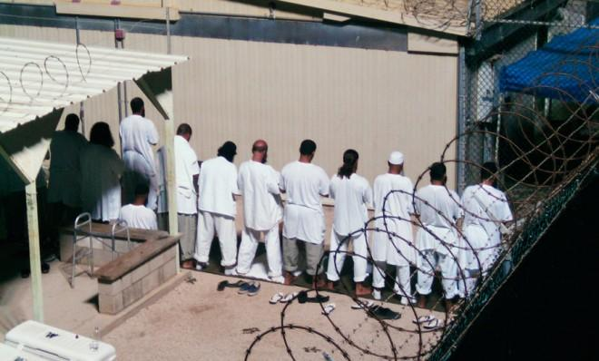 Detainees participate in early morning prayer sessions at Camp IV in Guantanamo Bay in 2009.