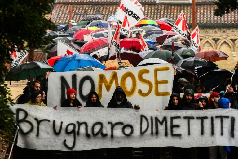 "Chanting slogans such as ""Venice resist"" and calling for Mayor Luigi Brugnaro's resignation, the marchers also appealed for a massive project, MOSE, to be mothballed"