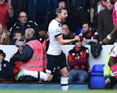 Kane lifts Spurs, Rashford downs City in derby