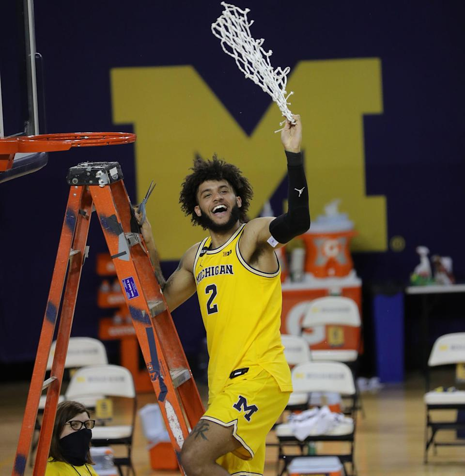 Michigan forward Isaiah Livers celebrates after clinching the Big Ten championship with a 69-50 win over Michigan State on Thursday, March 4, 2021, at the Crisler Center.