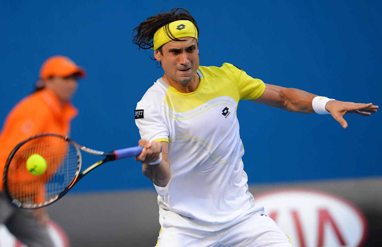 Spain's David Ferrer looks hits a return against Belgium's Olivier Rochus on day one of the Australian Open tennis tournament in Melbourne on January 14, 2013.  AFP PHOTO / WILLIAM WEST IMAGE STRICTLY RESTRICTED TO EDITORIAL USE - STRICTLY NO COMMERCIAL USEWILLIAM WEST/AFP/Getty Images