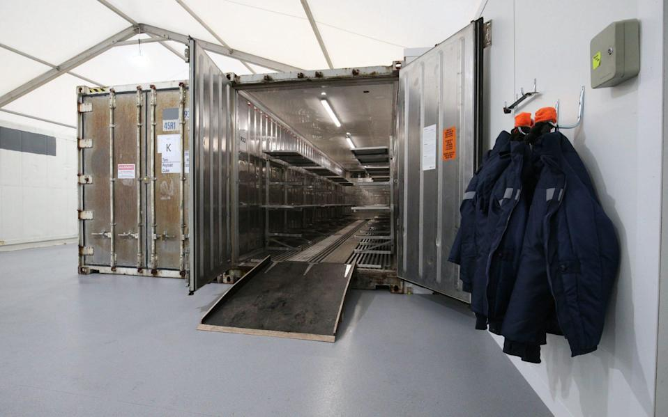 Inside one of the storage units at the overflow mortuary at Breakspear Crematorium in Ruislip, London - Jonathan Brady/PA