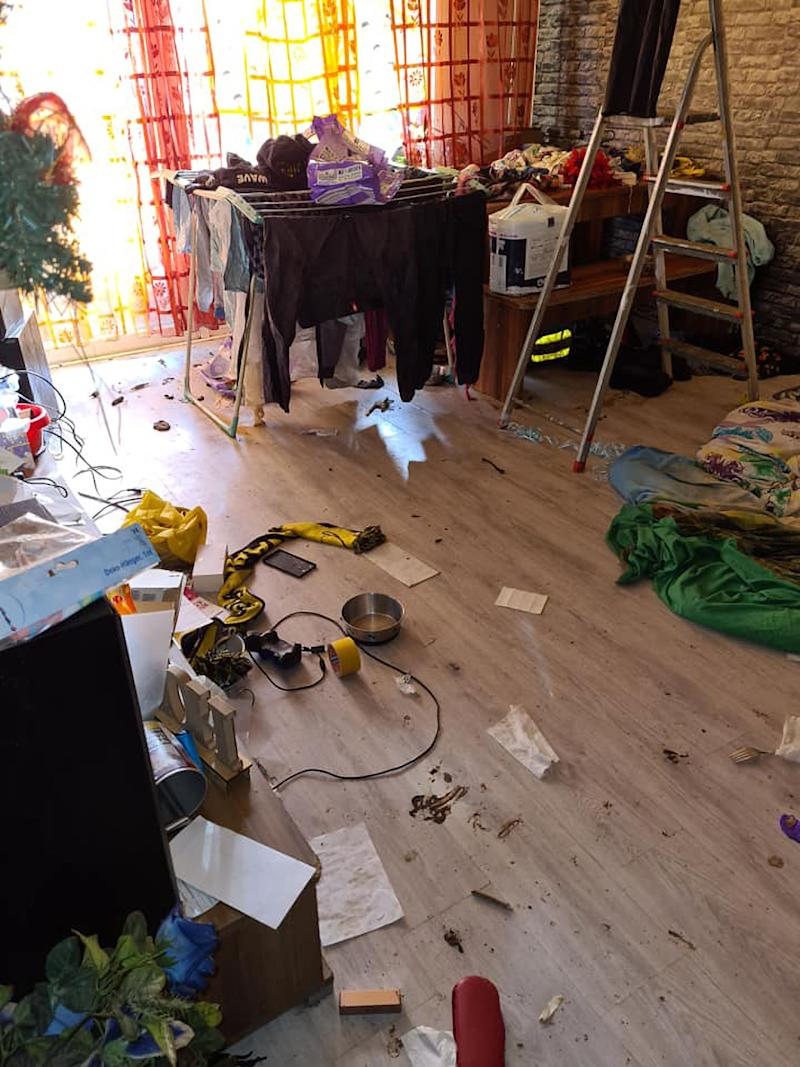 Rubbish and filth strewn across the floor inside the apartment where the French bulldogs and cat were discovered.