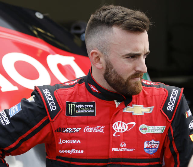 "<a class=""link rapid-noclick-resp"" href=""/nascar/sprint/drivers/1595/"" data-ylk=""slk:Austin Dillon"">Austin Dillon</a> stands outside his garage during NASCAR auto racing practice at Daytona International Speedway, Saturday, Feb. 10, 2018, in Daytona Beach, Fla. (AP Photo/Terry Renna)"