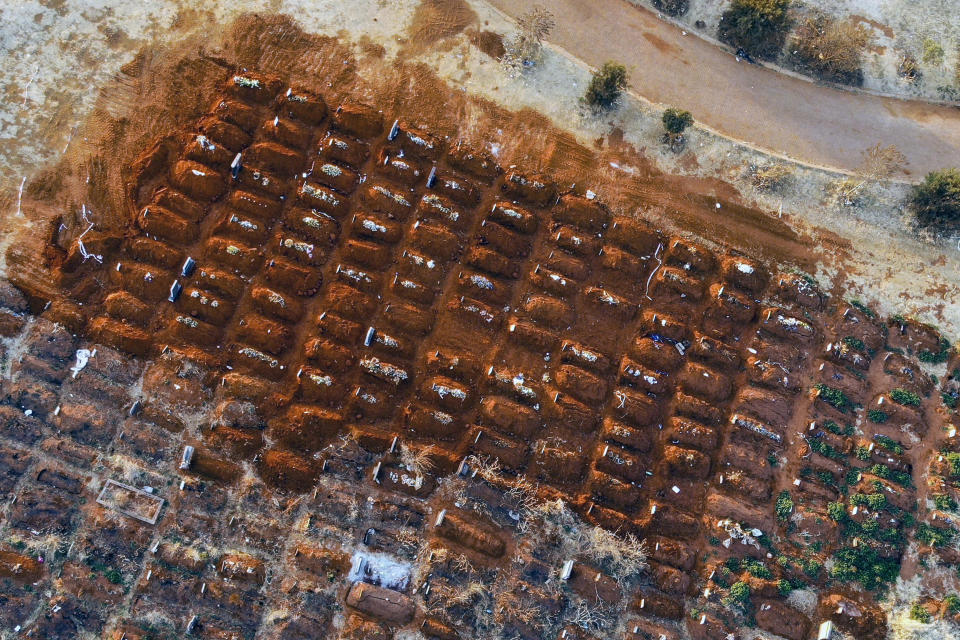 FILE - In this Aug. 5, 2020, file photo, recently filled graves are seen in the Olifantsveil Cemetery outside Johannesburg, South Africa. The African continent has surpassed 2 million confirmed cases as health officials warn of infections starting to creep up again into a second surge. (AP Photo/Jerome Delay/File)