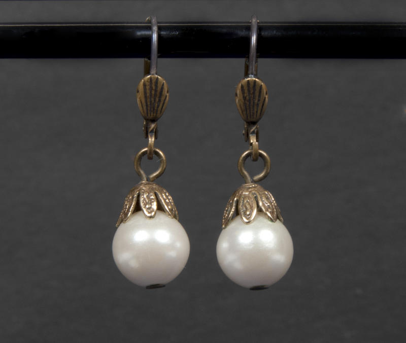 """This undated photo provided by Julien's Auctions shows a pearl drop earrings worn by Whitney Houston in """"The Bodyguard"""" and which sold for $2,812 at an auction in Beverly Hills of memorabilia from the late pop star's career on Saturday, March 31, 2012, in Beverly Hills, Calif. (AP Photo/Julien's Auctions)"""