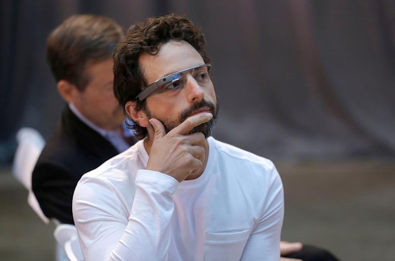 "Google co-rounder Sergey Brin wears Google Glass glasses at an announcement for the Breakthrough Prize in Life Sciences at Genentech Hall on UCSF's Mission Bay campus in San Francisco, Wednesday, Feb. 20, 2013. Google is giving more people a chance to pay $1,500 for a pair of the Internet-connected glasses that the company is touting as the next breakthrough in mobile computing. The product, dubbed ""Google Glass,"" will be offered to ""bold, creative individuals"" selected as part of a contest announced Wednesday. Participants must live in the U.S. and submit an application of up to 50 words explaining what they would do with the Google Glass technology. (AP Photo/Jeff Chiu)"