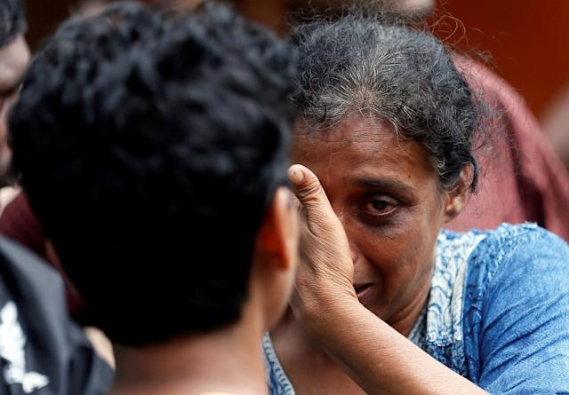<p>A relative of a victim reacts at a landslide site during a rescue mission in Athwelthota village, in Kalutara, Sri Lanka, May 28, 2017. (Dinuka Liyanawatte/Reuters) </p>