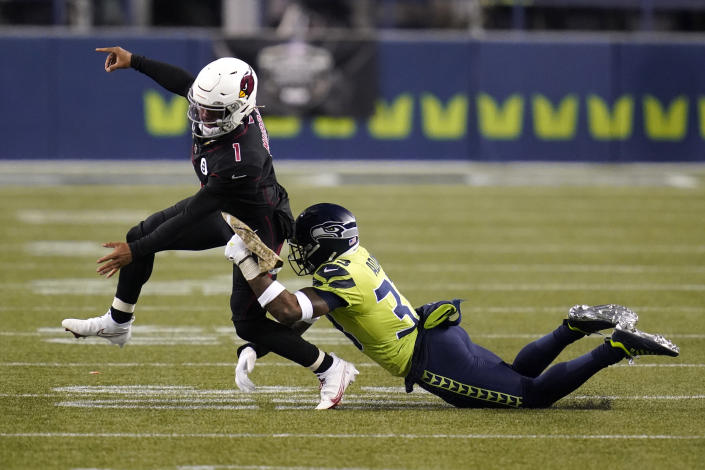 Seattle Seahawks strong safety Jamal Adams, right, gets to Arizona Cardinals quarterback Kyler Murray (1) just as Murray gets a pass off, during the second half of an NFL football game, Thursday, Nov. 19, 2020, in Seattle. (AP Photo/Elaine Thompson)