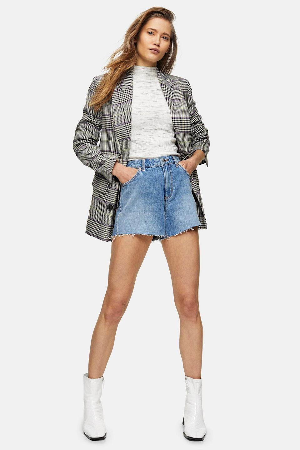 """<p><strong>Topshop</strong></p><p>topshop.com</p><p><strong>$51.00</strong></p><p><a href=""""https://go.redirectingat.com?id=74968X1596630&url=https%3A%2F%2Fus.topshop.com%2Fen%2Ftsus%2Fproduct%2Fpremium-blue-denim-mom-shorts-9649744&sref=https%3A%2F%2Fwww.cosmopolitan.com%2Fstyle-beauty%2Ffashion%2Fg10327302%2Fcute-fall-outfits%2F"""" rel=""""nofollow noopener"""" target=""""_blank"""" data-ylk=""""slk:Shop Now"""" class=""""link rapid-noclick-resp"""">Shop Now</a></p><p>Don't put your cutoffs in storage just yet. Give them a few more wears by adding a mockneck shirt and an oversized blazer. White boots also make them more seasonally appropriate. </p>"""