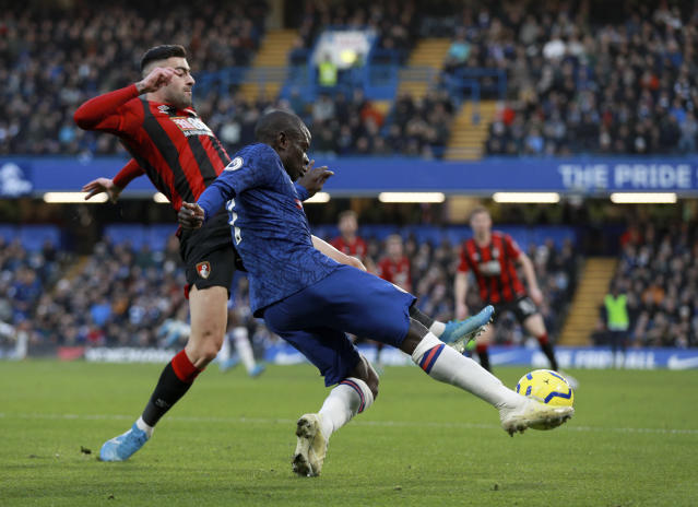 Bournemouth's Diego Rico, left, tries to block a shot from Chelsea's N'Golo Kante during the English Premier League soccer match between Chelsea and Bournemouth, at Stamford Bridge in London, Saturday, Dec. 14, 2019. (AP Photo/Ian Walton)