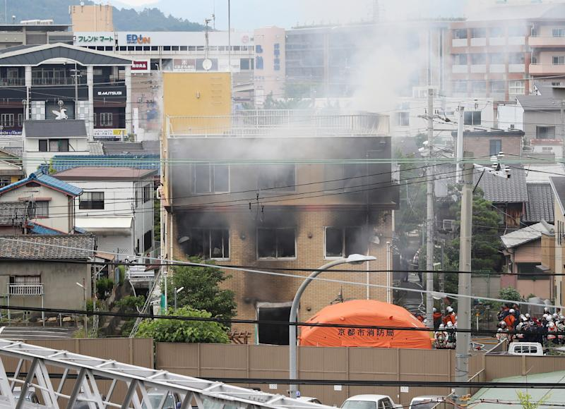 Smoke comes out from the animation company building after a fire in Kyoto (Photo credit should read JIJI PRESS/AFP/Getty Images)