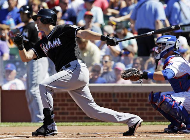 Miami Marlins' Ed Lucas hits a single against the Chicago Cubs during the first inning of a baseball game in Chicago, Friday, June 6, 2014. (AP Photo/Nam Y. Huh)