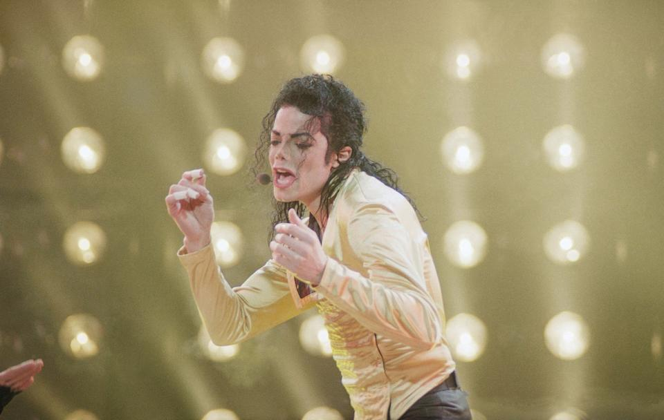 American entertainer Michael Jackson sings during his first and only concert in the former Soviet Union on a rainy night at Moscow's Olympic Stadium in Moscow, Wednesday, Sept. 15, 1993. (AP Photo/Alexander Zemlianichenko)