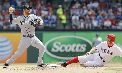Seattle Mariners second baseman Dustin Ackley, left, looks to throw to first after forcing out Texas Rangers' Ian Kinsler, right, in the fifth inning of a baseball game in Arlington, Texas, Sunday, April 21, 2013. Texas won 11-3. (AP Photo/Brandon Wade)