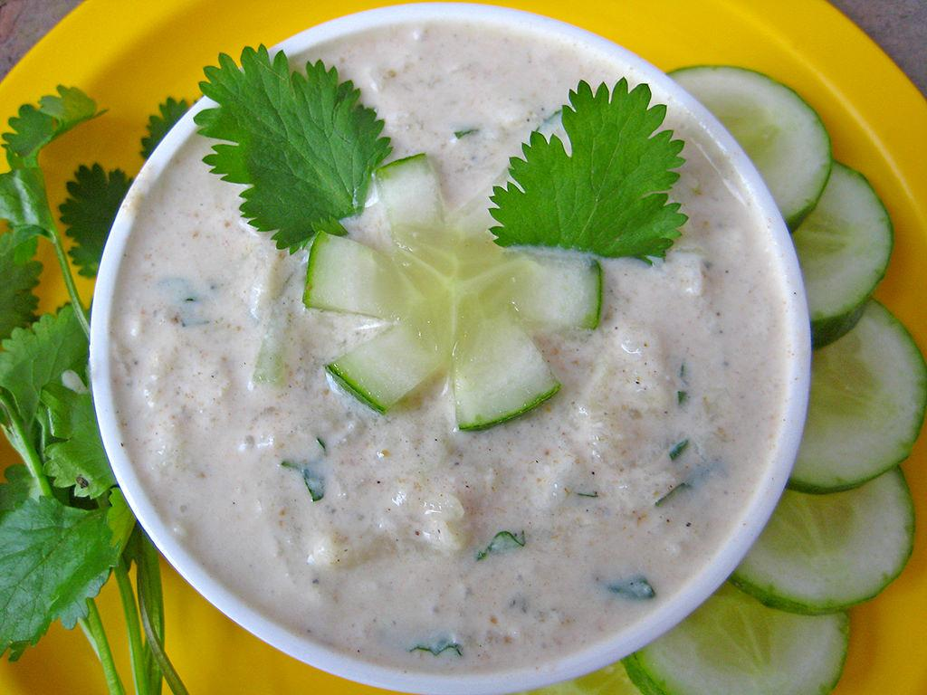 """<p>Cucumber is a cooling agent and is known for its numerous health benefits. Here's how to make a raita with cucumber. Add 1 diced or grated cucumber to a bowl of whisked yogurt. Add dry spice powders, salt or rock salt as required. Give it a good stir.Season it with chopped coriander or mint leaves. One can even add onions and tomatoes to this preparation. """"Creative Commons Cucumber Raita"""" by Sonia Goyal is licensed under CC BY 2.0 </p>"""