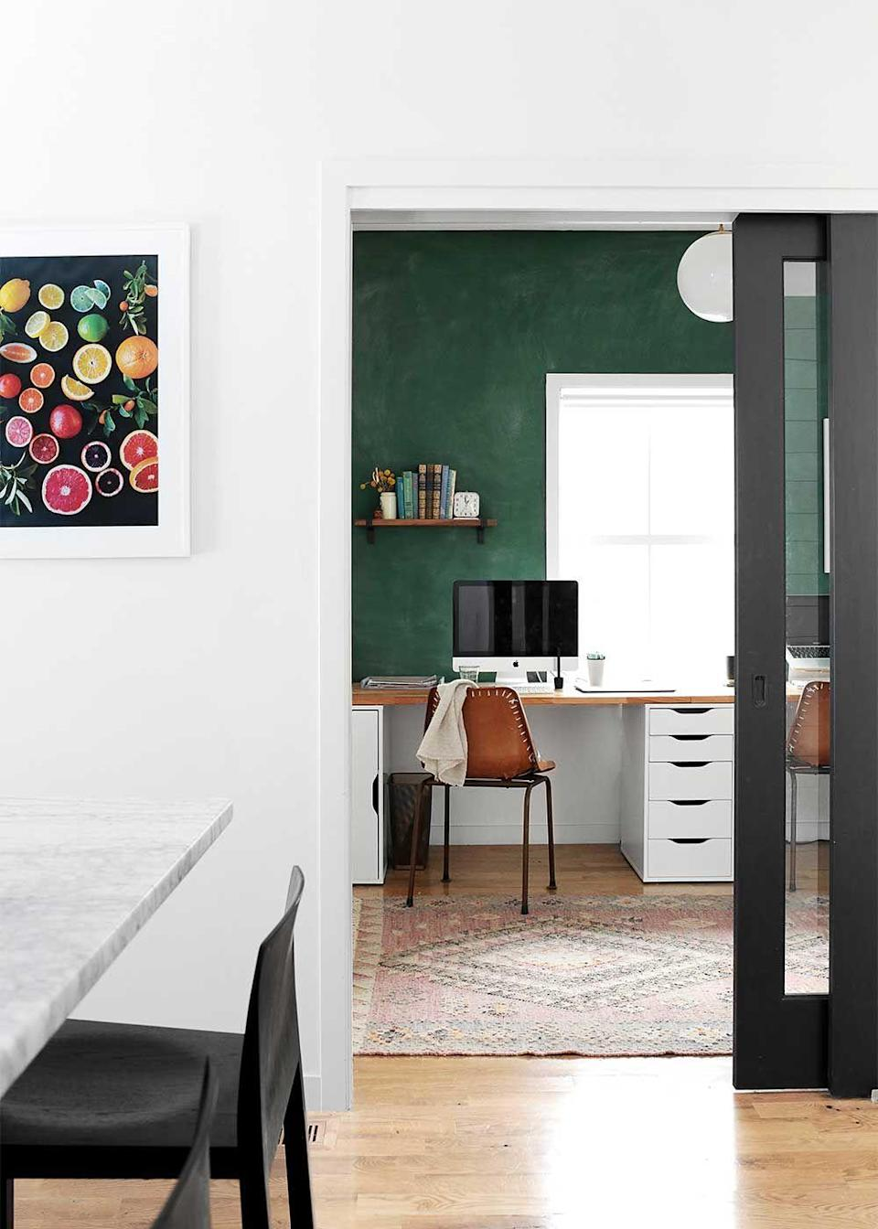 """<p>Give the room a warm and inviting feel by painting one of the walls a rich hue like hunter green, navy, or whichever color best matches your accessories. </p><p><em><a href=""""https://www.thefauxmartha.com/2016/02/26/schoolhouse-green-office/"""" rel=""""nofollow noopener"""" target=""""_blank"""" data-ylk=""""slk:See more at The Faux Martha »"""" class=""""link rapid-noclick-resp"""">See more at The Faux Martha »</a></em><strong><br></strong></p><p><strong>RELATED:</strong> <a href=""""https://www.goodhousekeeping.com/home-products/interior-paint-reviews/g2308/interior-paints/"""" rel=""""nofollow noopener"""" target=""""_blank"""" data-ylk=""""slk:The Best Interior Paint You Can Buy"""" class=""""link rapid-noclick-resp"""">The Best Interior Paint You Can Buy </a><br></p>"""