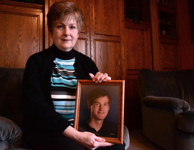 In this Feb. 16, 2013 photo, Karen Williams poses with a photo of her deceased son, Loren, in Beaverton, Ore.. Williams, who battled Facebook over the right to view Loren's Facebook page, has been urging lawmakers for years to do something to prevent others from losing photos, messages and other memories that otherwise could be accessed at the click of a mouse. This year the Oregon Legislature took up the cause, only to be turned back by pressure from the tech industry, which says they must abide by a 1986 federal law that prevents them from sharing such information. (AP Photo/Lauren Gambino)