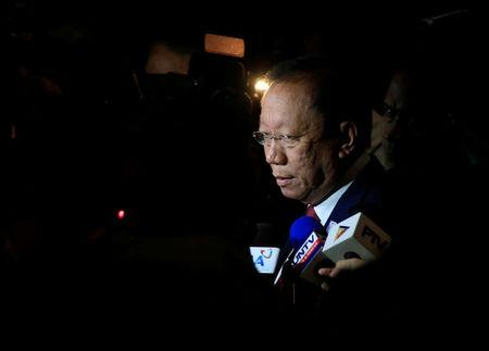 Solicitor General Jose Calida speaks to journalists as the Supreme Court starts the oral arguments on the consolidated petitions to declare Philippine President Rodrigo Duterte's drug war unconstitutional, in Manila, Philippines November 21, 2017. REUTERS/Romeo Ranoco