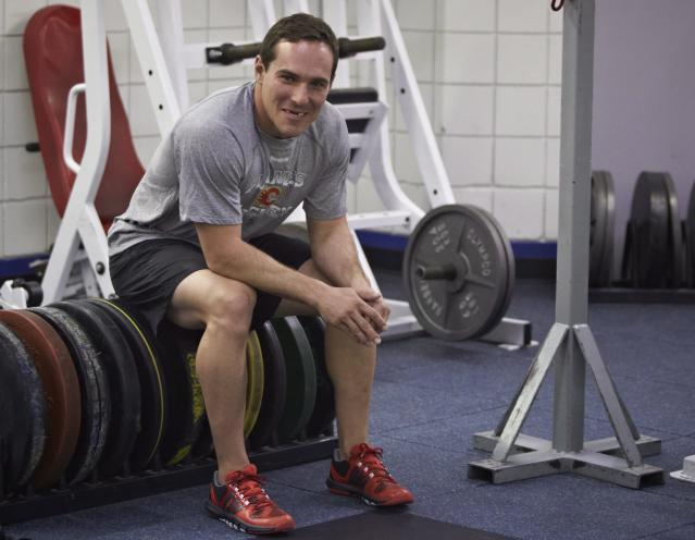 Calgary Flames NHL hockey player Mike Cammalleri rests during a training camp fitness test in Calgary, Alberta, Wednesday, Sept. 11, 2013. (AP Photo/The Canadian Press, Joff McIntosh)