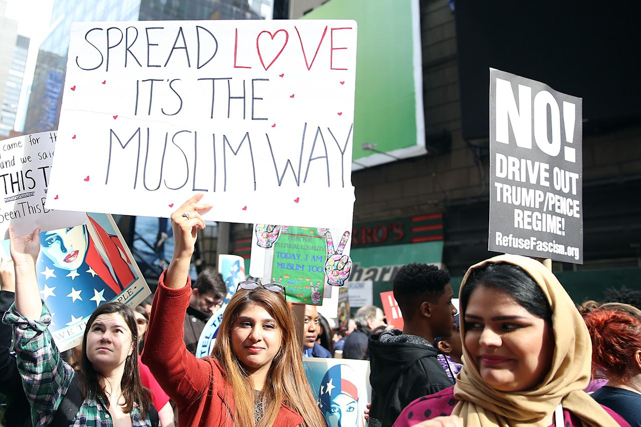 """<p>Several young women demonstrate holding up signs during the """"I am a Muslim too"""" rally in Times Square, New York City on Feb. 19, 2017. (Gordon Donovan/Yahoo News) </p>"""