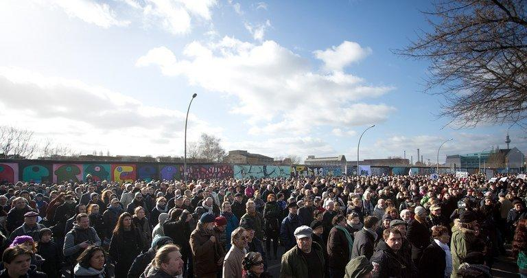 People gather in front of the Berlin Wall to demonstrate against the planned removal of part of it on March 3, 2013