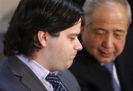 "Mark Karpeles (L), chief executive of Mt. Gox, attends a news conference at the Tokyo District Court in Tokyo February 28, 2014. Mt. Gox, once the world's biggest bitcoin exchange, filed for bankruptcy protection on Friday, saying it may have lost all of its investors' virtual coins due to hacking into its faulty computer system. Karpeles, bowing in contrition and wearing a suit instead of his customary T-shirt, apologised in Japanese at a news conference for the company's collapse, blaming ""a weakness in our system."" REUTERS/Yuya Shino"