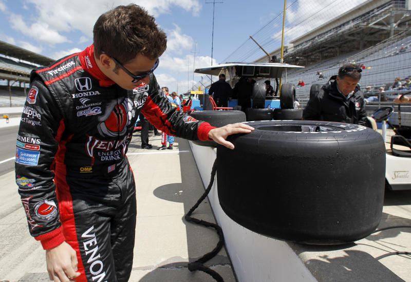In this May 16, 2011 photo, IndyCar driver Marco Andretti looks over one of the tires removed from his car during practice for the Indianapolis 500 at the Indianapolis Motor Speedway in Indianapolis. The Speedway started as a testing ground for the automotive industry and a century later it still is perfecting items such as the rear-view mirror, safer tires and other high-tech advancements.(AP Photo/Darron Cummings)