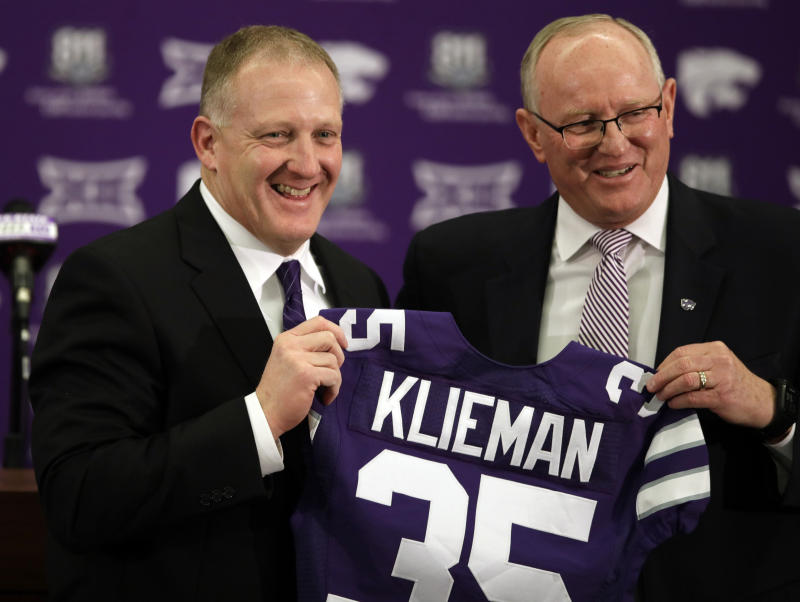 Chris Klieman, left, is introduced as the 35th Kansas State NCAA college football head coach by athletic director Gene Taylor, right, in Manhattan, Kan., Wednesday, Dec. 12, 2018. (AP Photo/Orlin Wagner)