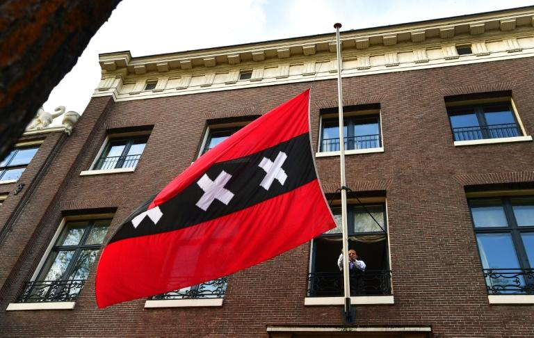 The flag of Amsterdam was flown at half-mast in front of Van der Laan's office on Friday