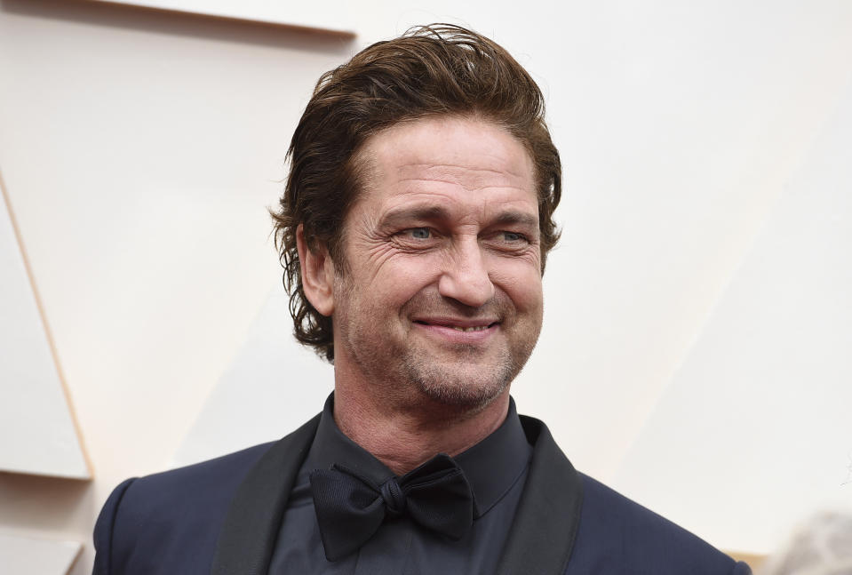 Gerard Butler arrives at the Oscars on Sunday, Feb. 9, 2020, at the Dolby Theatre in Los Angeles. (Photo by Jordan Strauss/Invision/AP)