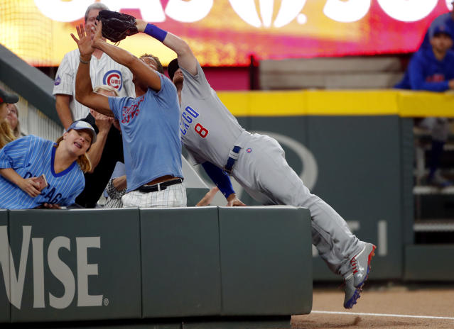 Chicago Cubs left fielder Ian Happ can't reach a foul ball from Atlanta Braves' Nick Markakis during the ninth inning of a baseball game Tuesday, May 15, 2018, in Atlanta. Chicago won 3-2. (AP Photo/John Bazemore)