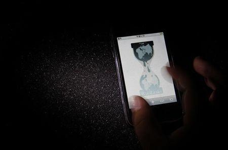 Logo of the Wikileaks website is pictured on a smartphone in Tokyo