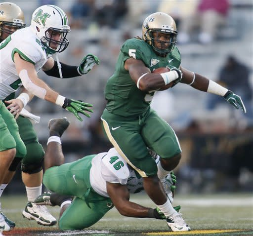 Marshall linebacker Billy Williams (27) looks to bring down UAB running back Darrin Reaves (5) in the first half of an NCAA college football game at Legion Field in Birmingham, Ala., Saturday, Nov. 10, 2012. (AP Photo/Hal Yeager)