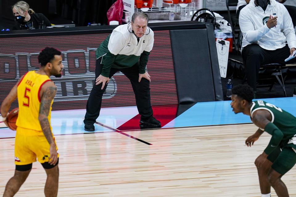 Michigan State head coach Tom Izzo watches from the bench as his team plays against Maryland in the first half of an NCAA college basketball game at the Big Ten Conference tournament in Indianapolis, Thursday, March 11, 2021. (AP Photo/Michael Conroy)