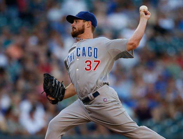 SEATTLE, WA - JUNE 28: Starting pitcher Travis Wood #37 of the Chicago Cubs pitches against the Seattle Mariners at Safeco Field on June 28, 2013 in Seattle, Washington. (Photo by Otto Greule Jr/Getty Images)