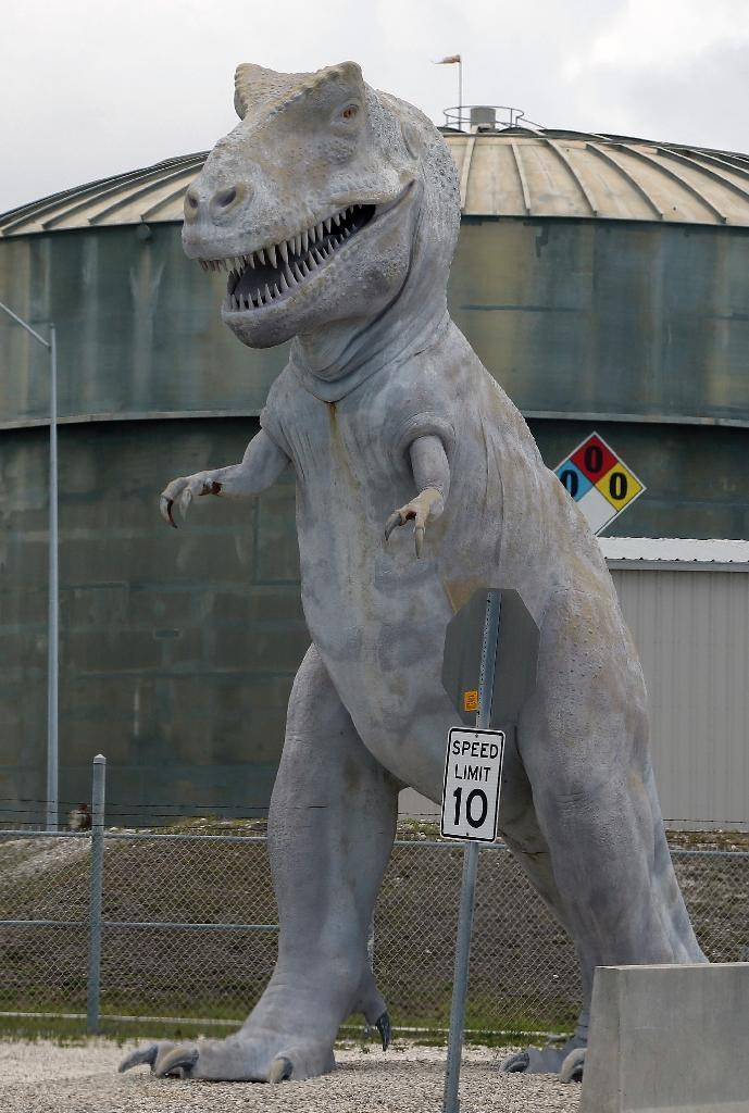 The dinosaur statue outside the Turkey Point Nuclear Power Plant was intended to symbolise the fate of fossil fuel power generation (AFP Photo/RHONA WISE )