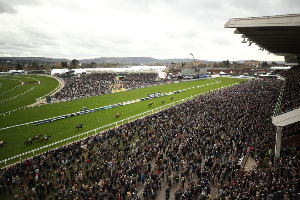FILE - In this Wednesday March 11, 2020 file photo, a general view from the Grand Stand as Envoi Allen ridden by Davy Russell wins the Ballymore Novices' Hurdle day two of the Cheltenham Horse Racing Festival at Cheltenham Racecourse, England. More than 100,000 people have died in the United Kingdom after contracting the coronavirus. That's according to government figures released Tuesday Jan. 26, 2021. Britain is the fifth country in the world to pass that mark, after the United States, Brazil, India and Mexico, and by far the smallest. The U.S. has recorded more than 400,000 COVID-19 deaths, the world's highest total, but its population of about 330 million is about five times Britain's. (Tim Goode/PA via AP, File)