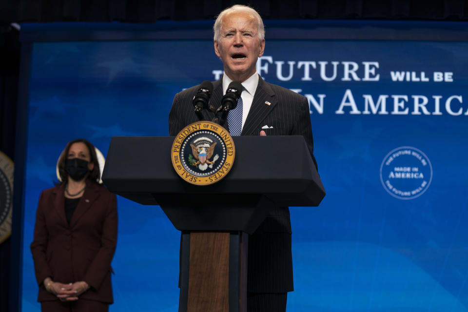 Vice President Kamala Harris listens as President Joe Biden speaks during an event on American manufacturing, in the South Court Auditorium on the White House complex, Monday, Jan. 25, 2021, in Washington. (AP Photo/Evan Vucci)