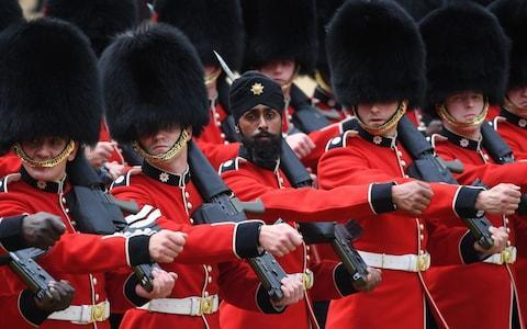 <span>Coldstream Guards soldier Charanpreet Singh Lall wearing a turban during a rehearsal for Trooping the Colour</span> <span>Credit: Stefan Rousseau /PA </span>