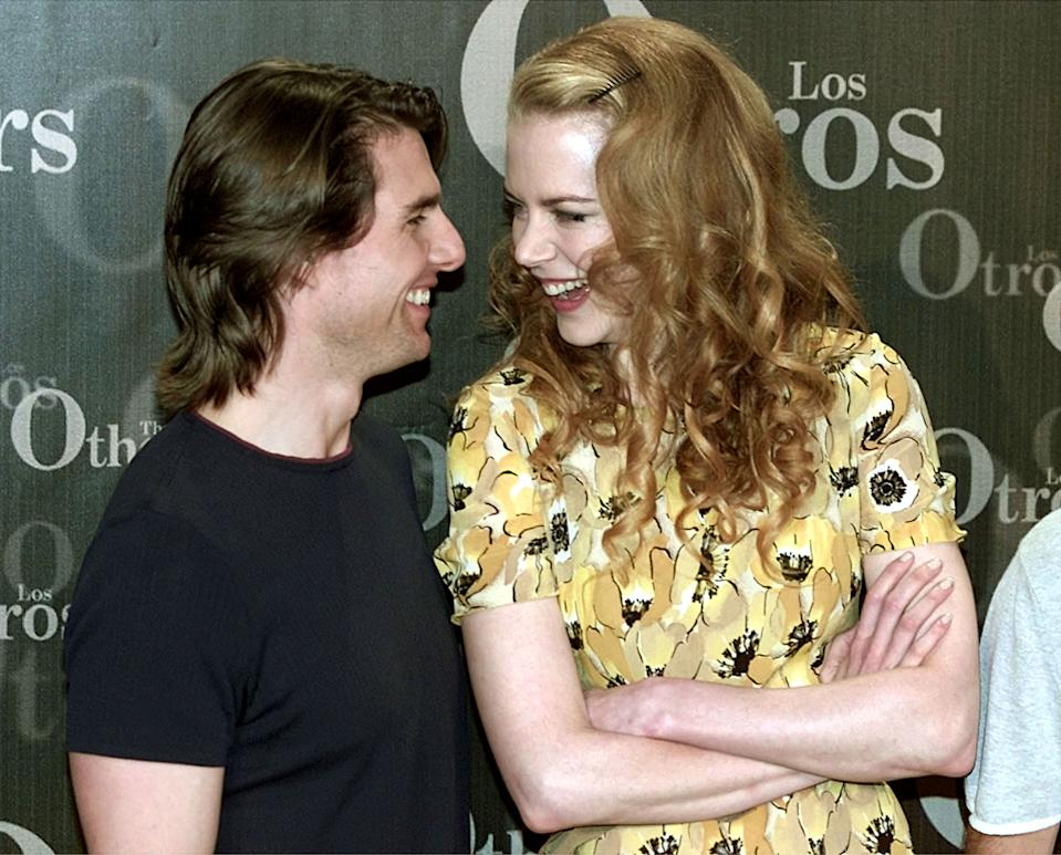 """Australian actress Nicole Kidman and her husband US actor Tom Cruise smile during a photocall in a Madrid hotel July 26, 2000. Kidman will star in the film """"The Others"""", directed by  Alejandro Amenabar and co-produced by Cruise, which is being filmed in Spain."""