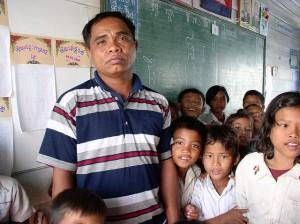 Grimacing teacher surrounded with kids