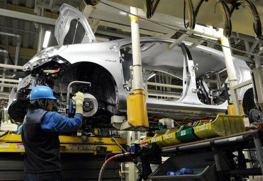 A worker assembles a car at a Toyota factory. Toyota has regained its position as the world's number one automaker